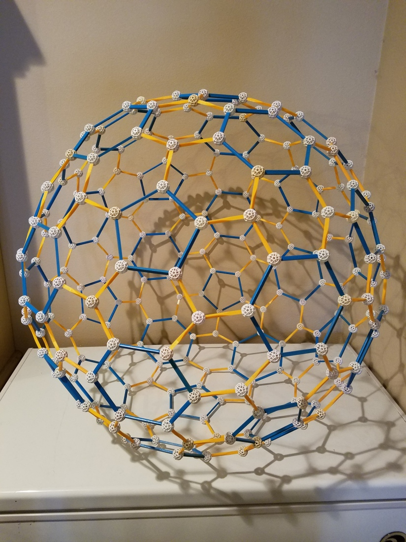 The Construction of a Zome Model of a 240-Atom Fullerene Molecule, In SevenPictures
